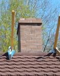 кирпичный дымоход буржуйки jotul на крыше