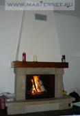пристенный камин с чугунным топливником