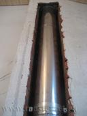 дымоходная гильза печи проложена в кирпичном канале в стене