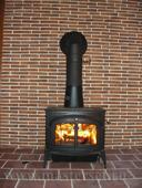 облицовка стены за печь, установка канадской печки encore catalitic classic black