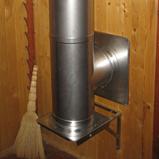 модульный дымоход с тройником конденсатосборника смонтирован в доме